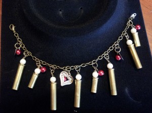 Bracelet with heart charm, red beads, 22lr casing with pearl beads.
